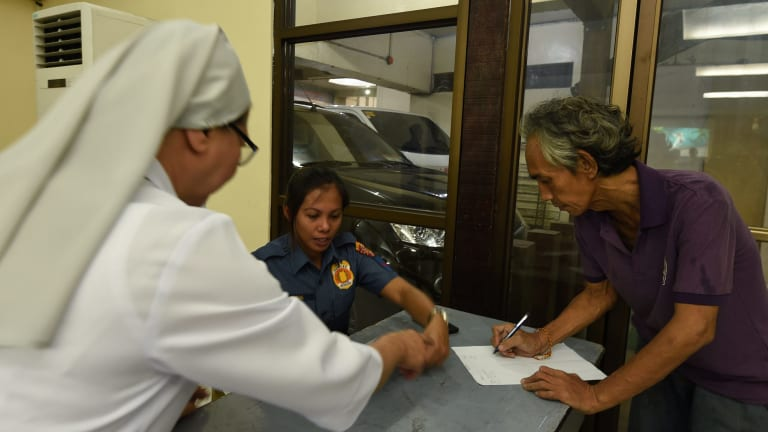 Every Wednesday those who surrender sign in to attend a rehabilitation session  run by the church, the local district and police. Ten sessions are supposed to guarantee amnesty.