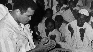Former world heavyweight boxing champion Muhammad Ali, who has condemned Donald Trump's remarks about banning Muslims from entering the United States, is seen here in 1988 praying at a mosque in Khartoum, Sudan.