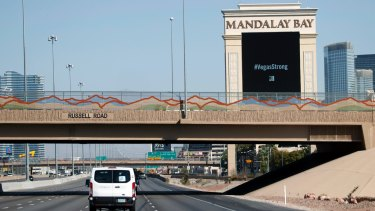 President Donald Trump's motorcade passes the Mandalay Bay Resort and Casino on the way to meet with victims and first responders of the mass shooting.