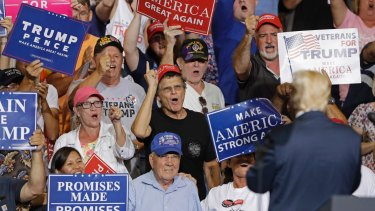 Supporters cheers for US President Donald Trump in Huntington, West Virginia last week. Trump has continued with campaign-style rallies after his election.