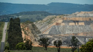 An open-cut coal mine looms over Muswellbrook.