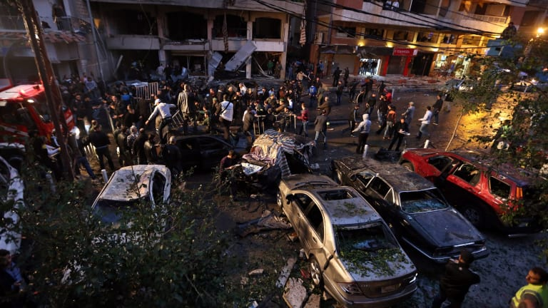 Lebanese gather at the site of an explosion during rush hour in southern Beirut, the stronghold of Hezbollah, in January 2014.