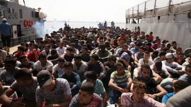 The Libyan coast guard took hundreds of migrants who were trying to reach Europe illegally by boat into custody, following an altercation with a volunteer rescue vessel.