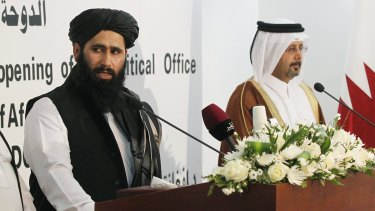 """Muhammad Naeem, left, a spokesman for the Taliban, at the opening of the Taliban  political office in the Qatari capital Doha in June 2013, part of the fitful process of """"talks about talks""""."""