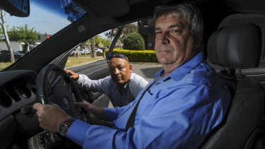 Prospective Uber drivers Teferi Gungul, left, and Gary Woodbridge will have their cars tested next week as Uber prepares to start operating in Canberra.