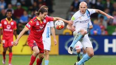 Aaron Mooy of Melbourne City (right) and Michael Marrone of Adelaide United fight for possession.