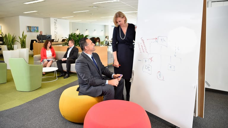 """KPMG national partner Susan Ferrier and chairman of Partners Con Tragakis with staff in KPMG's new """"agile"""" workspace."""