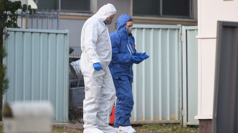 Forensic police examined the house on Danny Road in Lalor Park after a girl was shot dead.