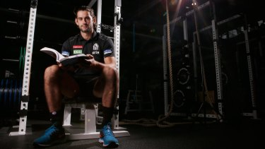 By the book: Collingwood footballer Brodie Grundy ensures he has a full life outside football.