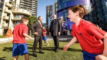 Education Minister James Merlino and Housing Minister and Albert Park MP Martin Foley with students from Port Melbourne Primary School.