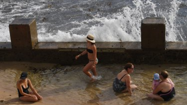 Cool relief: Sydney's temperatures passed 30 degrees by 9:30am.