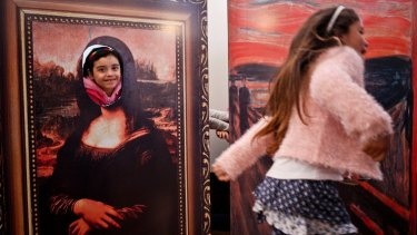 Transgender girls Selenna, right, and Genesis who poses inside a Mona Lisa painting, play during celebrations marking Transgender Children's Day in Santiago, Chile, last year.