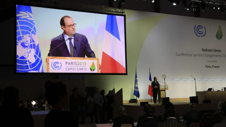 'Never have the stakes of an international meeting, and I say never, been higher' ... French President Francois Hollande speaks at the opening ceremony of the COP21.