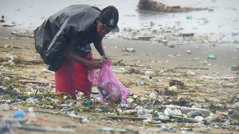 One recycling scheme offers Indonesia's trash pickers health insurance in exchange for rubbish.
