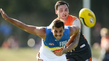 The Suns' Andrew Boston is challenged by GWS player Nathan Wilson during a NAB Challenge match earlier this year.
