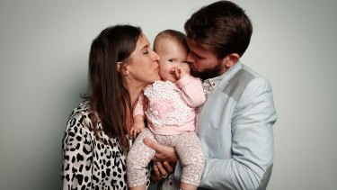 Bethan McElwee and Jonathan McElwee with their one-year-old daughter Aviana in Canberra last month.