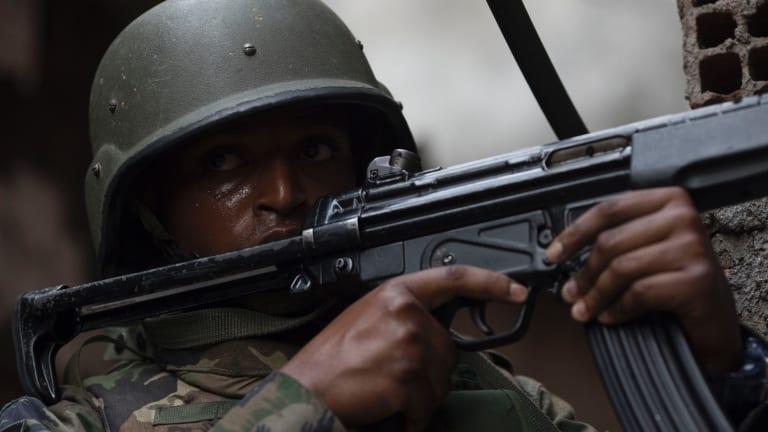 A soldier takes a position in an alley of the Rocinha favela in Rio de Janeiro.