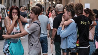 Pedestrians in shock moments after the van drove through crowds on Las Ramblas in Barcelona.