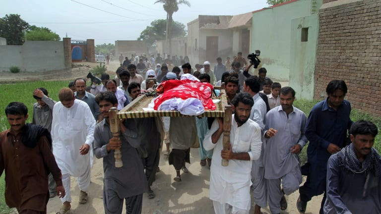 Relatives and local residents carry the coffin of slain model Qandeel Baloch for funeral prayers in Shah Sadar Din village, near Dera Ghazi Khan, Pakistan.