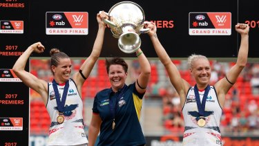 Chelsea Randall, Bec Goddard and Erin Phillip hold the cup aloft after the Crows won the inaugural AFLW Premiership.