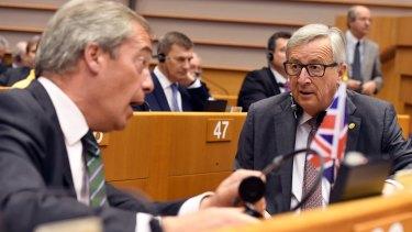 European Commission President Jean-Claude Juncker, speaks with  Farage.