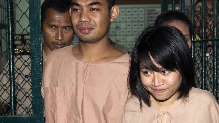Patiwat Saraiyaem, 23, and Porntip Mankong, 26, leave Bangkok's Criminal Court after being sentenced on charges of lese majeste.