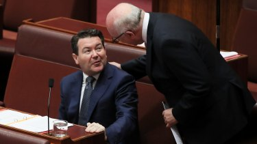 Senator Dean Smith and Attorney-General George Brandis during the Senate debate of Smith's bill.