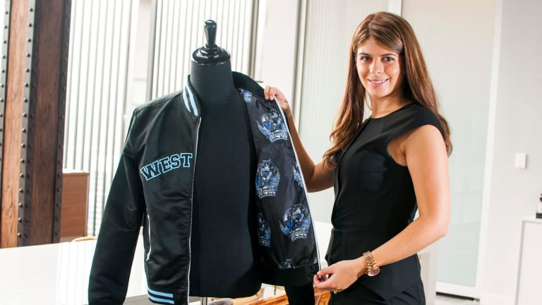 Daniels, founder of Exodus Wear, shows off one of the company's bomber jackets.