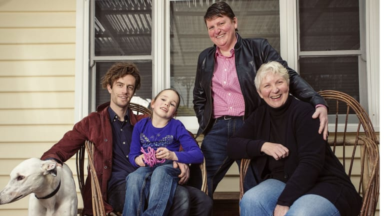 Victoria's new gender and sexuality commissioner Rowena Allen (standing), with her partner Kaye and their children Sam and Alex.