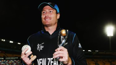 Martin Guptill of New Zealand holds the player of the match trophy after the quarter-final against the West Indies.