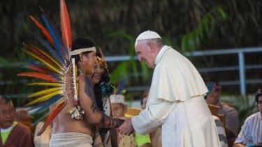Pope Francis greets indigenous representatives in Puerto Maldonado.