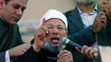 February 2011: Yusuf al-Qaradawi speaks to the crowd at Friday prayers in Tahrir Square in Cairo.