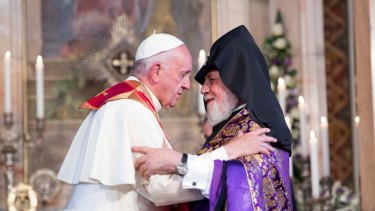 Pope Francis greeted by Catholicos Karekin II, right, as he visits the Apostolic Cathedral of Etchmiadzin in Yerevan on Friday.