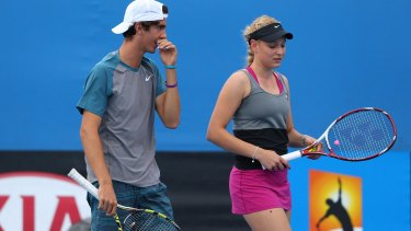 Caught in the middle: Thanasi Kokkinakis and Donna Vekic at the 2014 Australian Open.