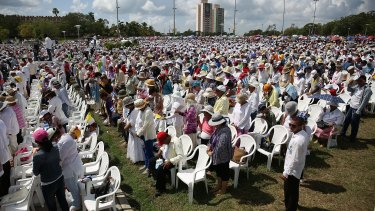 Cubans pray during Mass in the Plaza de la Revolution held by Pope Francis.