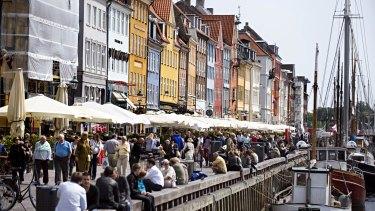 Happy: People enjoying the Nyhan riverside in Denmark.