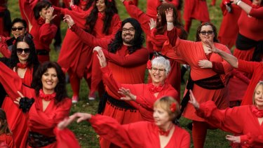 Beards among the flashmob. Men and women unite to swoop and sway to Kate Bush's <i>Wuthering Heights</I>.