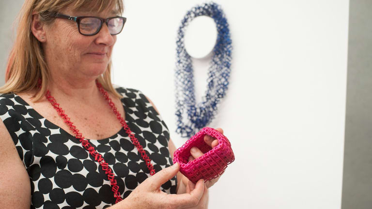 Jeweller Bin Dixon-Ward holding one  of her 3D printed pieces.