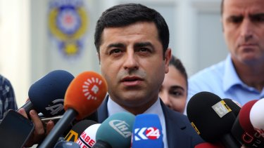 Pro-Kurdish Peoples Democracy Party leader Selahattin Demirtas speaks to the media about Turkey's air strikes against Kurdish rebel bases in Iraq on Monday.