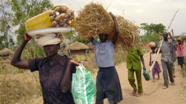 Villagers in northern Uganda flee following new attacks by the Lord's Resistance Army in 2006.