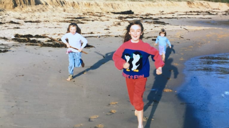 Julia Gardiner (left), Mary Gardiner (centre) and Stephanie Gardiner (right) run on Putty Beach, on the NSW Central Coast, in about 1990.