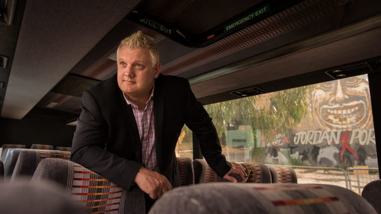 Simon Rowe inspects a coach he plans to convert into a free Sleep Bus for the homeless this winter.