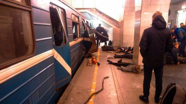 Blast victims lie near a subway train hit by a explosion at the Tekhnologichesky Institut subway station in St.Petersburg, Russia.