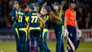 Charlotte Edwards of England walks off after losing her wicket.