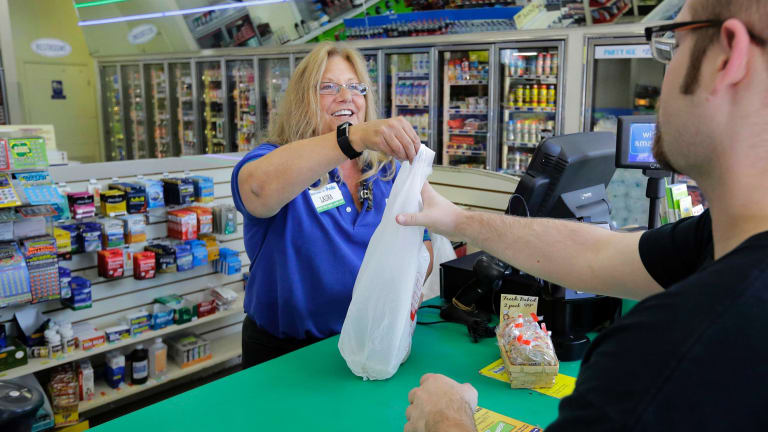 A cashier makes a sale at the Pride Station & Store which sold the winning ticket.