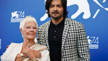 Judi Dench, left, and Ali Fazal pose during a photo call for the film Victoria And Abdul at the 74th Venice Film Festival in Venice, Italy.