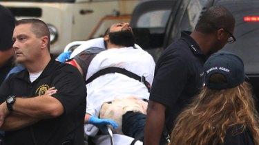 Rahami being taken into custody.