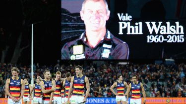 Adelaide players paid tribute to coach Phil Walsh last July.