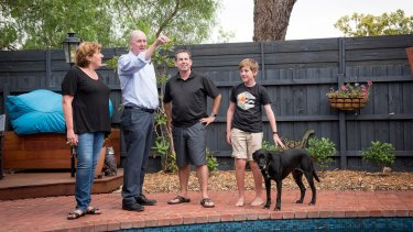 Planning Minister Richard Wynne (middle) with the McMahon family - Claire, Steve and son Joseph - in Mentone.