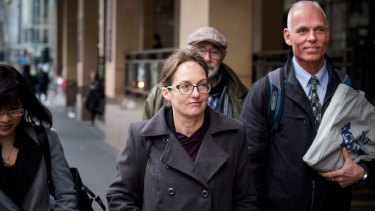 Kathy Clubb, centre, outside the Melbourne Magistrates Court in August.